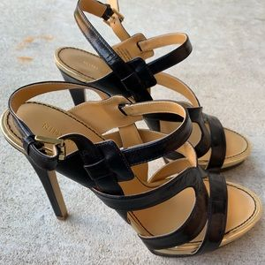 Nine West. Size 10. Black and gold strappy heels.